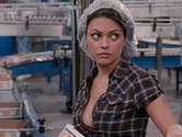 Mila Kunis flashes her sexy hooters and flaunts a bikini-covered ass
