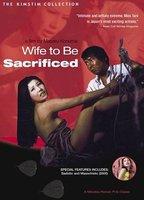 Naomi Tani as Akiko in Wife to Be Sacrificed